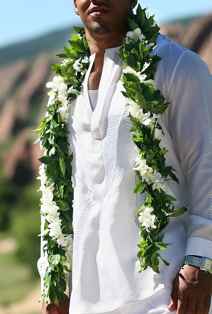 Traditionally worn by the groom, the rainforest-scented maile lei is intertwined with beautiful white orchids.                                                                                                                                                     More