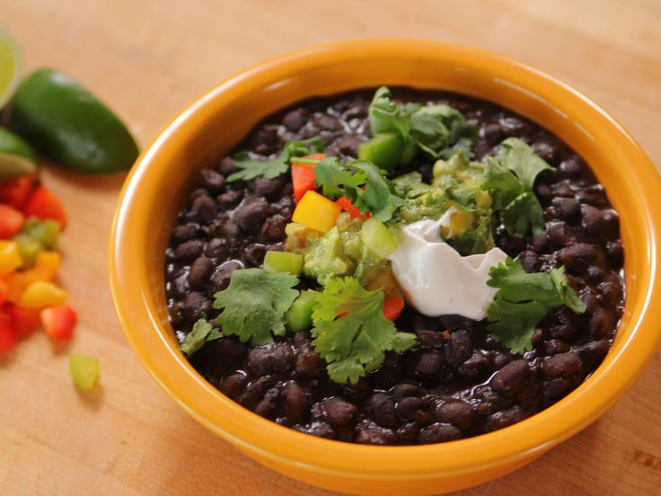 Black Beans recipe from Ree Drummond via Food Network   (Use Veggie Broth in place of the Chicken Broth)