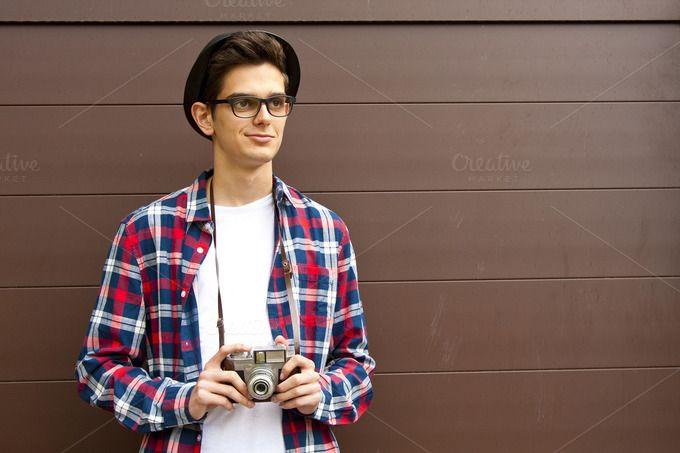 boy with vintage photo camera by pruden.alvarez on @creativemarket