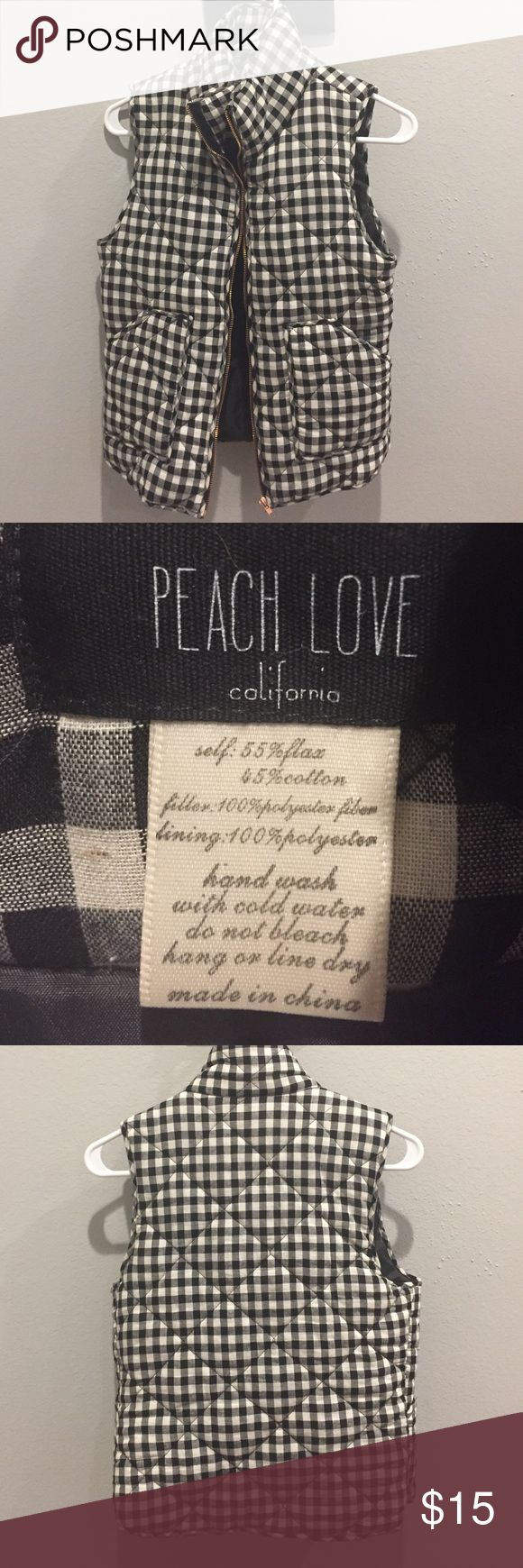 Black and white checkered vest Black and white checkered vest. States that it's a size small, but it fits like an extra small. Peach Love California Jackets & Coats Vests