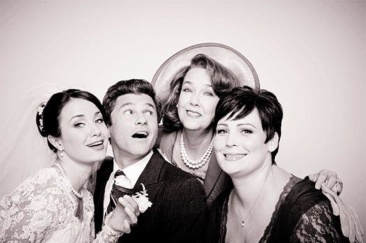 "The Steinbergs and Howards joining together for an adorable photo op. | David Burtka And The Cast Of ""It Shoulda Been You"" Take Cute Wedding GIFs"