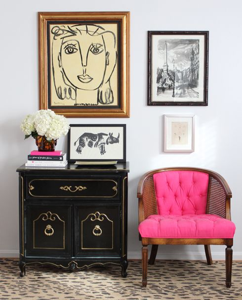 pretty pink chair, love the art and rug!