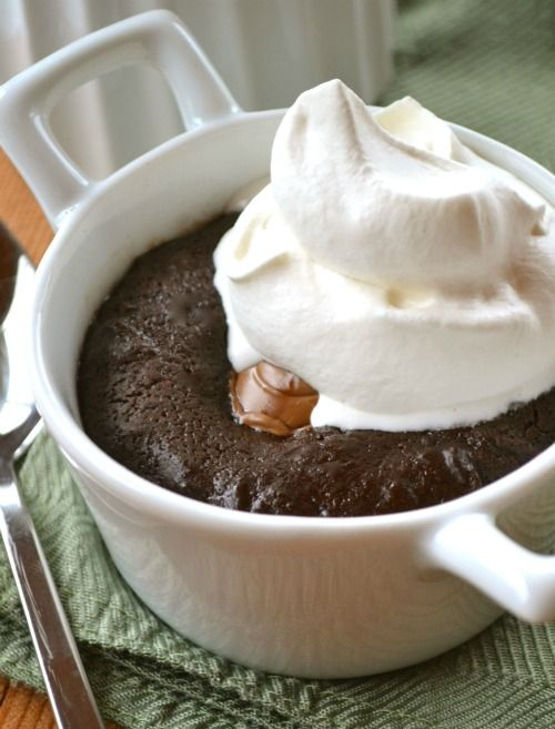 The quick route to a fudgy molten chocolate mug cake for one: tuck an Easter creme egg inside!