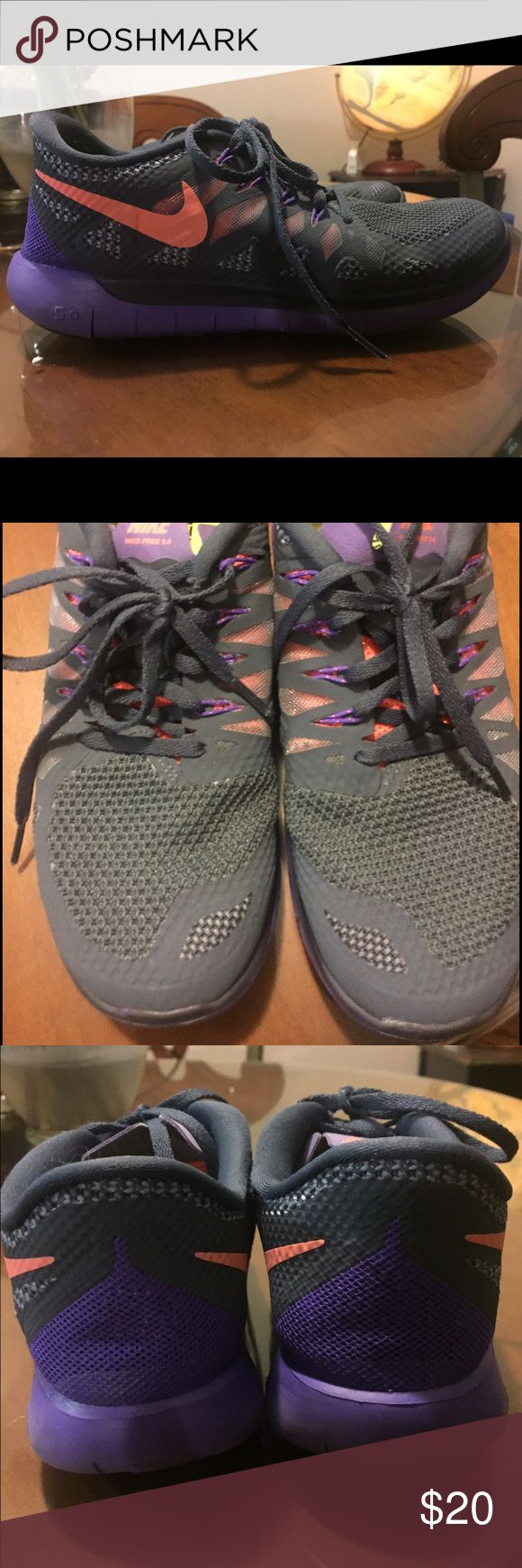 Nike free 5.0 Gray with orange/coral and purple detail. Worn, but good condition. I love these shoes, but my feet are just too wide for them. Great for cross training  type exercises. Nike Shoes Sneakers