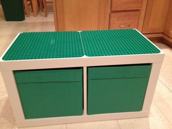 Ikea Expedit two cube unit, Ikea storage containers, two Duplo bases and two tubes of epoxy glue.... One super awesome Duplo table! My husband rocks! by Laura Winslow