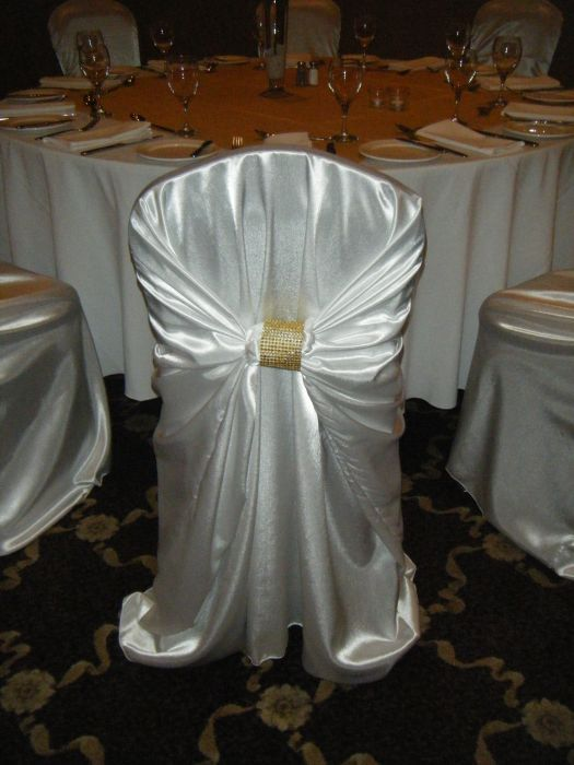 White Satin Chair Covers. The Satin Chair Covers are actually a Wrap.  This enables this cover to fit a wide variety of chair sizes.  The Clasp on the back comes in either silver or gold (add .50).