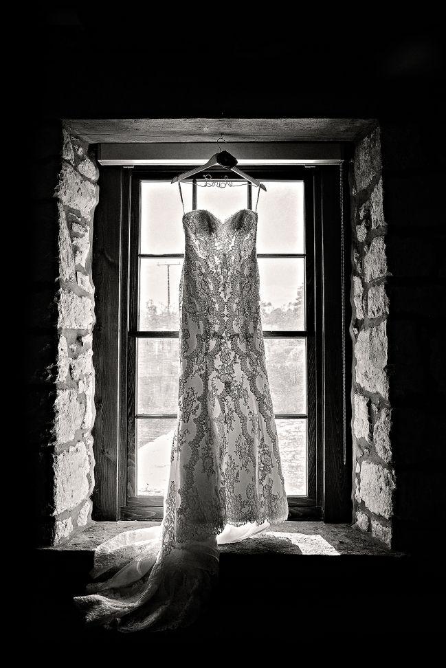 Wedding dress in window at Cambridge Mill - Melissa Avey Photography