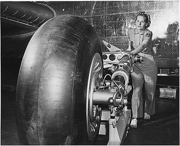 The landing gear for a B-25 bomber being rolled onto the final assembly line of North American's Inglewood plant