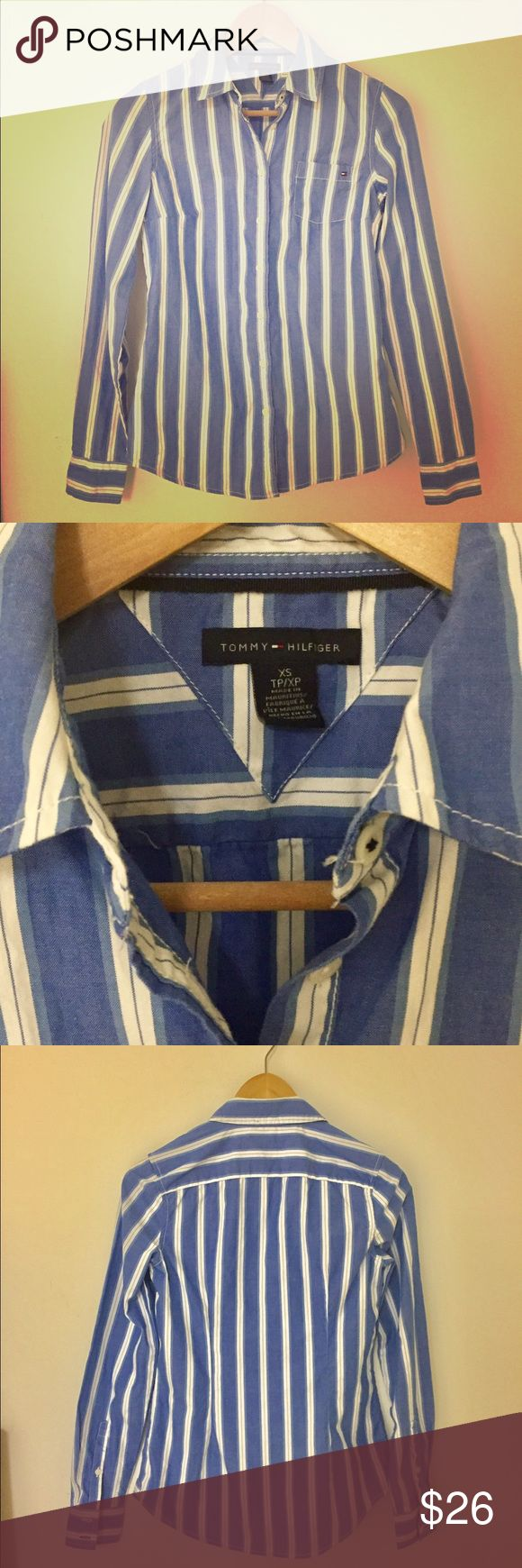 TOMMY HILFIGER Striped Oxford Button Down Shirt TOMMY HILFIGER women's Oxford shirt. Classic American style and comfort. MSRP $79. • Size XS • 100% cotton  • Long sleeves  • Button down  • Blue with white stripes & white buttons Tommy Hilfiger Tops Button Down Shirts