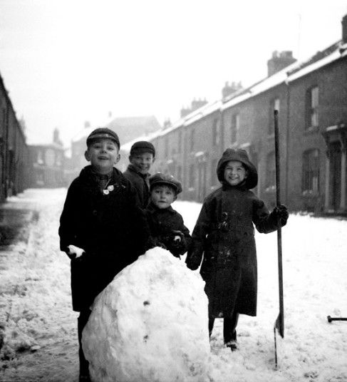 Kids making a Snowman, in the Street in the 1950s, In Northampton, England