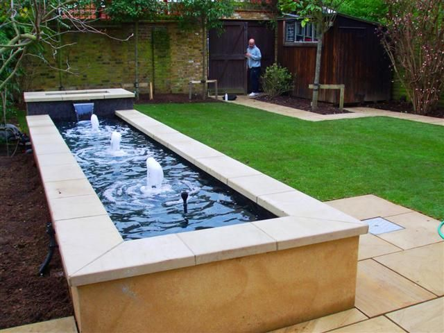 25 best ideas about raised pond on pinterest koi pond for Concrete fish pond construction and design