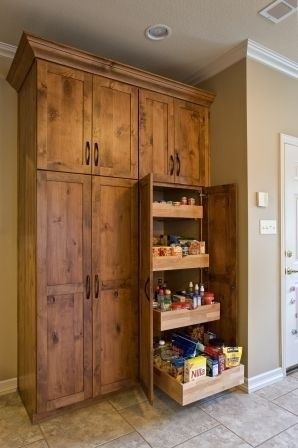 LOVE this cabinet color and rustic look. & that is an awesme pantry. Pull out drawers are awesome