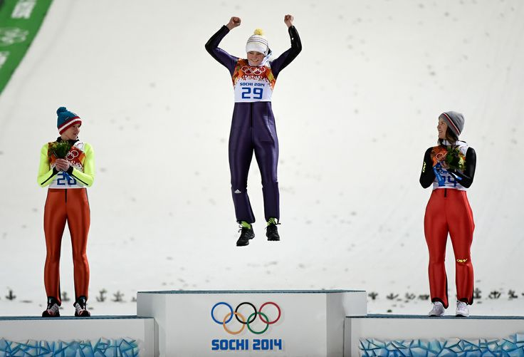 SOCHI, RUSSIA - FEBRUARY 11: (L-R) Silver medalist Daniela Iraschko-Stolz of Austria, gold medalist Carina Vogt of Germany and bronze medalist Coline Mattel of France on the podium during the flower ceremony for the Ski Jumping Ladies Normal Hill Individual on day 4 of the Sochi 2014 Winter Olympics at the RusSki Gorki Ski Jumping Center on February 11, 2014 in Sochi, Russia. (Photo by Lars Baron/Getty Images)
