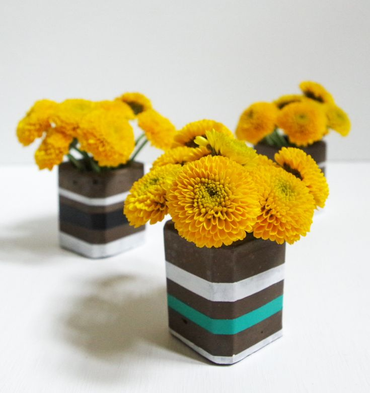 In an easy beginner cement project, I made modern cement bud vases using a silicone shot glass mold. These bud vases are so cute and would make a great gift!