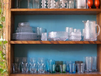 iittala on the shelves of jewelry designer Fay Andrada Sick's apartment. via of a kind