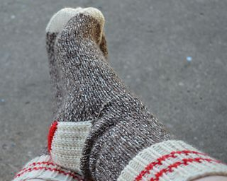 Winter Socks for the Family is a top down sock pattern with a heel flap and gusset, written for use with 5 DPNs. A wool/nylon blend aran or heavy worsted weight sock yarn is recommended for warmth and durability.