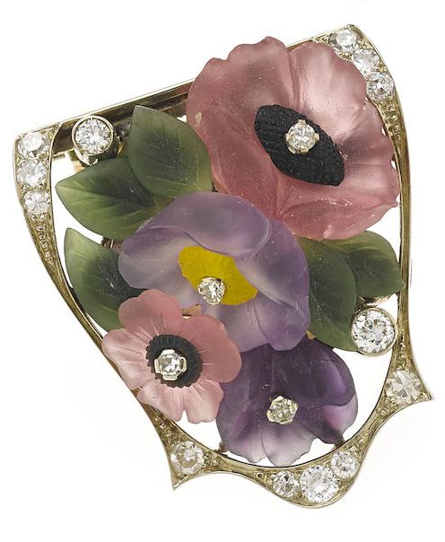 A carved gem-set and diamond flower dress clip, Austrian, circa 1935. With Austrian hallmarks; mounted in 18k white gold.: