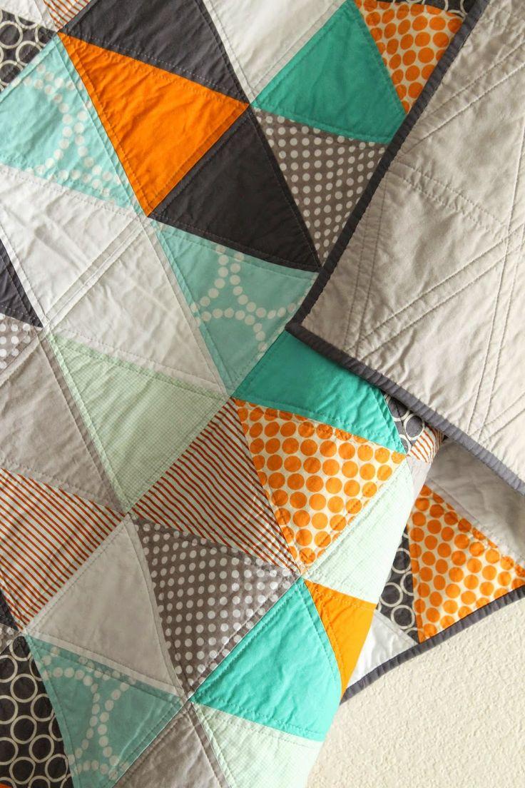 craftyblossom: orange and aqua isosceles triangle quilt.