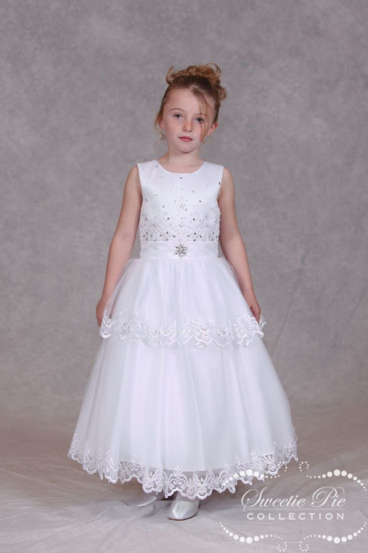 Designer First Communion Dress 3017 by Sweetie Pie features a 2 layer tulle skirt with embroidered lace trim. Designer First Communion Dress has peau satin bodice with stunning lace overlay with scattered rhinestones and sequins.  Designer First Communion Dress has satin band at waistline with bow on back. Designer First Communion Dress Sweetie Pie Communion Dresses use the […]