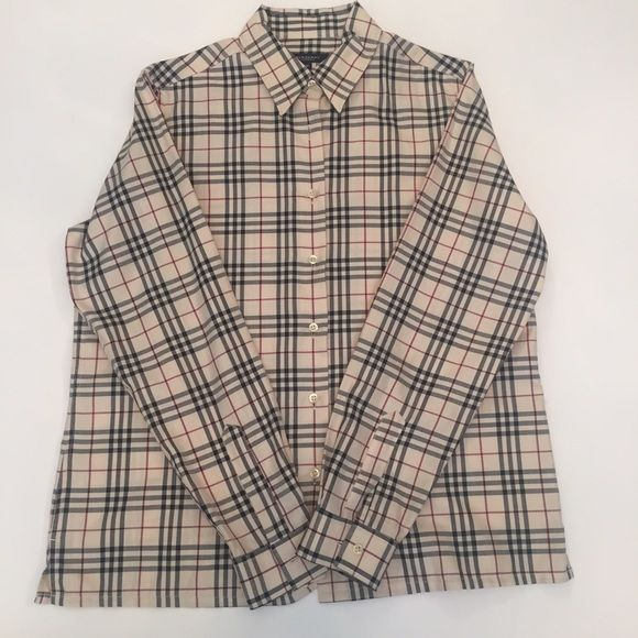 Burberry Shirt Authentic collared Burberry woman's shirt. This has been dry cleaned and pressed. I noticed one small stain on the back of the left sleeve (pictured) which is not very noticeable, only worn a few times, too small for me now. Posh rules only, no trade or PP. Offers negotiated using offer button only. Final Sale. Burberry Tops Button Down Shirts