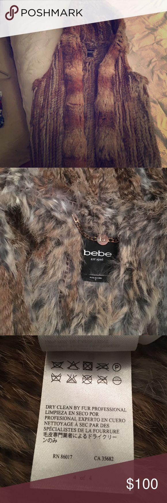 Rabbit fur vest Hip length hooded fur vest. REAL FUR great condition like new. Thin but warm. bebe Jackets & Coats Vests