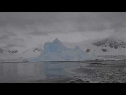 an iceberg collapses, causing an explosion-like effect