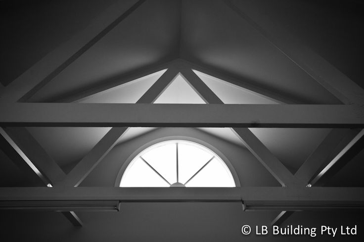 Interior of garage showing trusses and recycled window