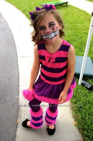 Cheshire Cat.  Boyify the outfit but I like the painted smile idea.