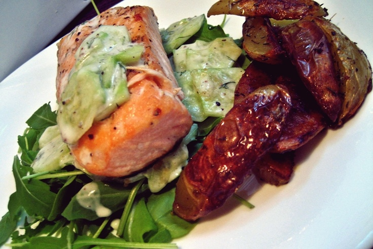 Salmon on cucumbers with natural yoghurt, vinegar, salt an pepper with baked potatoes. yum-yum! :)