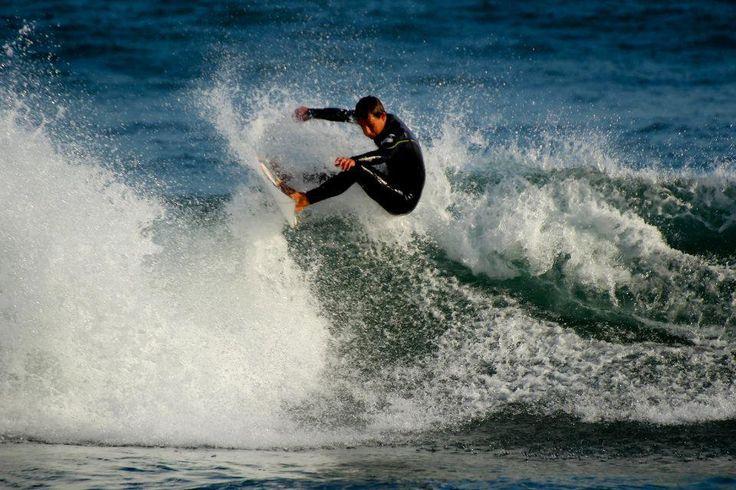 A surfer, in the Portugal beach