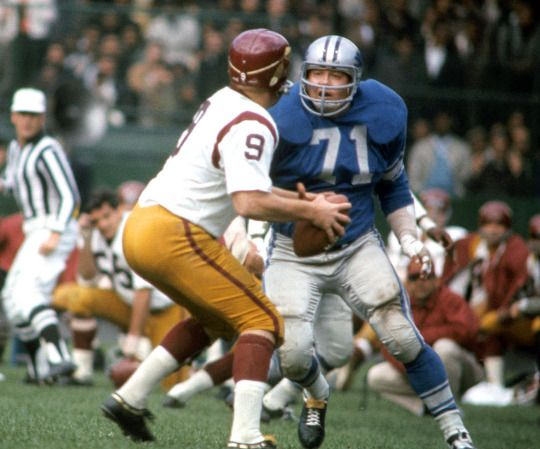 Lions DT Alex Karras looks to sack Redskins QB Sonny Jurgensen during a game on Oct. 3, 1965 in Detroit. The rugged Karras, who made four Pro-Bowls while anchoring the Detroit Lions' defense and then made a successful transition to an acting career, with a stint along the way as a commentator on Monday Night Football,
