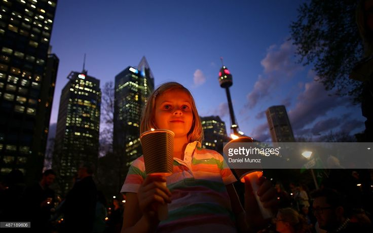 A girl holds candles in support of refugees on September 7, 2015 in Sydney, Australia. Thousands of people around Australia gathered to remember Aylan Kurdi, the young Syrian refugee who died last week and to protest the Australian Government's current refugee policy.