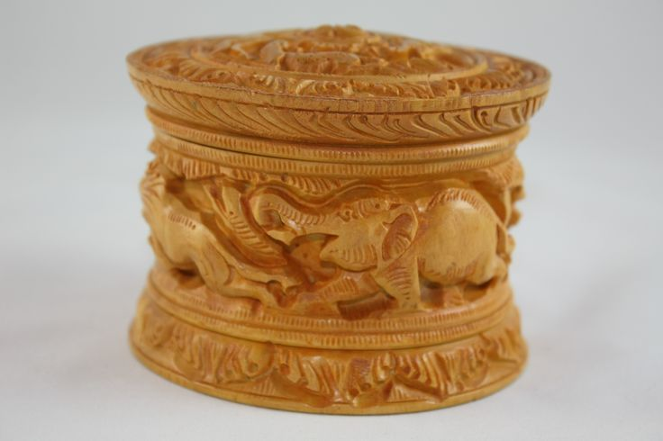 Beautifully carved wooden keep sake box with lid.