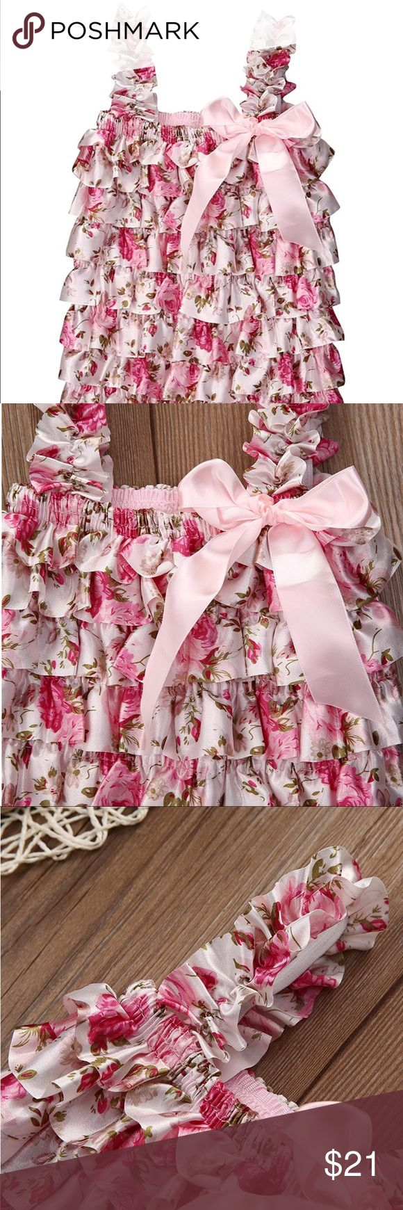 Ruffle romper Floral ruffle romper. Stretches around the chest area, the leg area and the straps. One Pieces