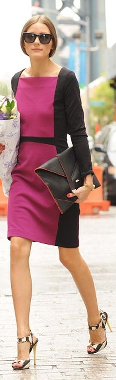 Who made Olivia Palermo's black envelope clutch handbag and pink color blocked dress that she wore in New York?