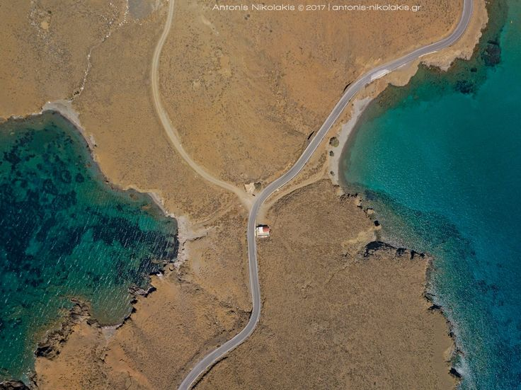 """Steno"", the small strip of land that separates Astypalaia in two parts and offers the unique shape of the island for which it is often characterised as ""Butterfly""...   www.astypalaia-island.gr Aerial Photo: Antonis Nikolakis Photography"