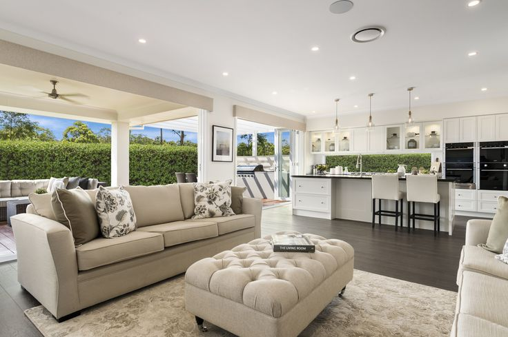 #Hamptons styling in the living hub of the Miami Executive on display in Sapphire Beach, Coffs Harbour. The sumptuous lounges, natural tones, stunning lighting and open living floor plan create this striking style. #style #interiordesign #interior #design