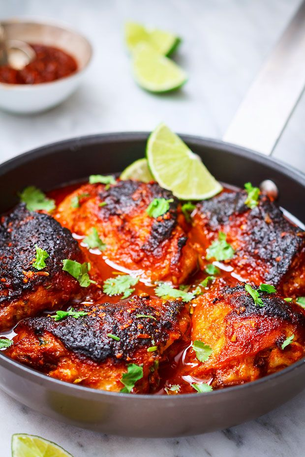 Sriracha baked chicken – chicken thighs coated with a spicy sriracha sauce, spices, and a handful of fresh cilantro. Simple, vibrant, and full of rich flavor.