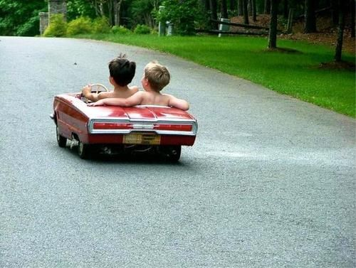Adorable pic of kids riding in toy car