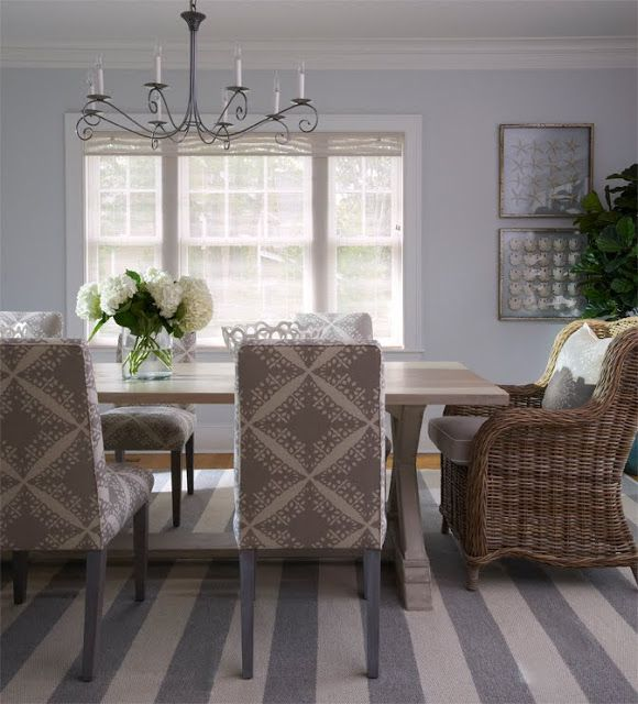 Dining Room With A Striped Grey And White Rug Upholstered Chairs Around Farmhouse Style