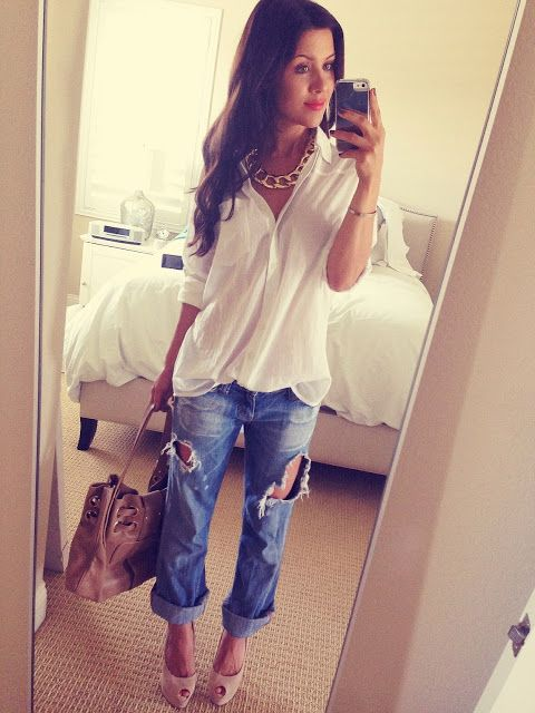 White blouse. Ripped rolled up jeans, gold necklace