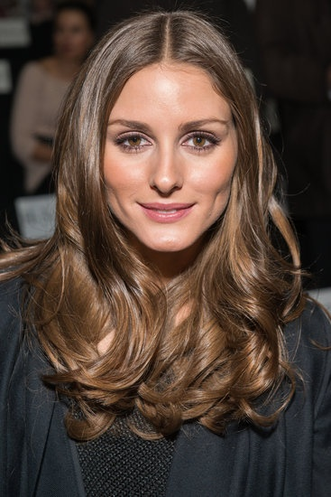 Olivia Palermo at the Diane von Furstenberg Fall 2013 show in glossy waves.