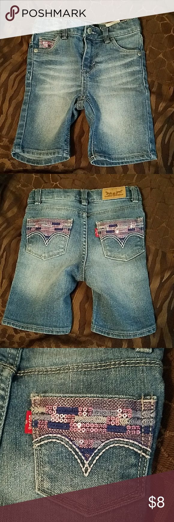Toddler girl 3T Toddler girl levis Bermuda shorts, size 3T. Sequin and decorative stitching on back pockets. Adjustable waist. Great condition. Levi's Bottoms Shorts