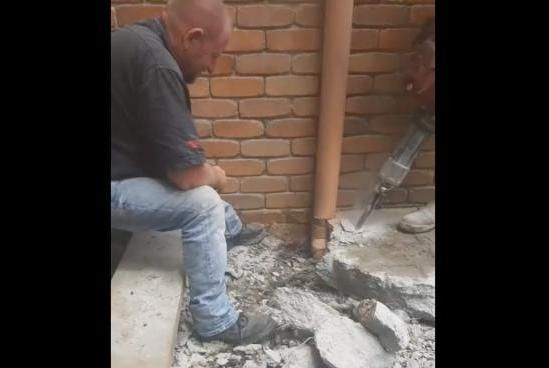 Unusual snake removal calls for use of jackhammers