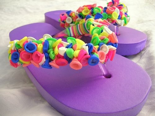 Dollar Day Creation~Balloon Flip Flops  This is a cute way to spruce up a boring pair of flip-flops. This is an easy summer craft to make flip flops that pop! These flip flops can also be made at slumber parties, luau, beach themed birthday parties or anytime youd like a cheap easy craft to keep kids entertained. These would make awesome party favors.    Need:  Flip flops ~ Dollar Tree  Water Balloons (about 200 per pair)  (It does take about 1 hr to complete so not good to make with the w