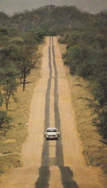 Zimbabwe - On the road - a strip road. I've looked and looked for a picture of this. Miles of 2 tarmac strips for the tires.When we went to live in Zimbabwe in 1977 the road from Beit Bridge to Harare looked like this. What an adventure.