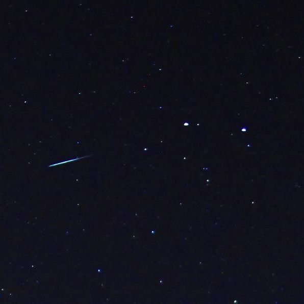 Meteor flying straight from Gemini's two brightest stars