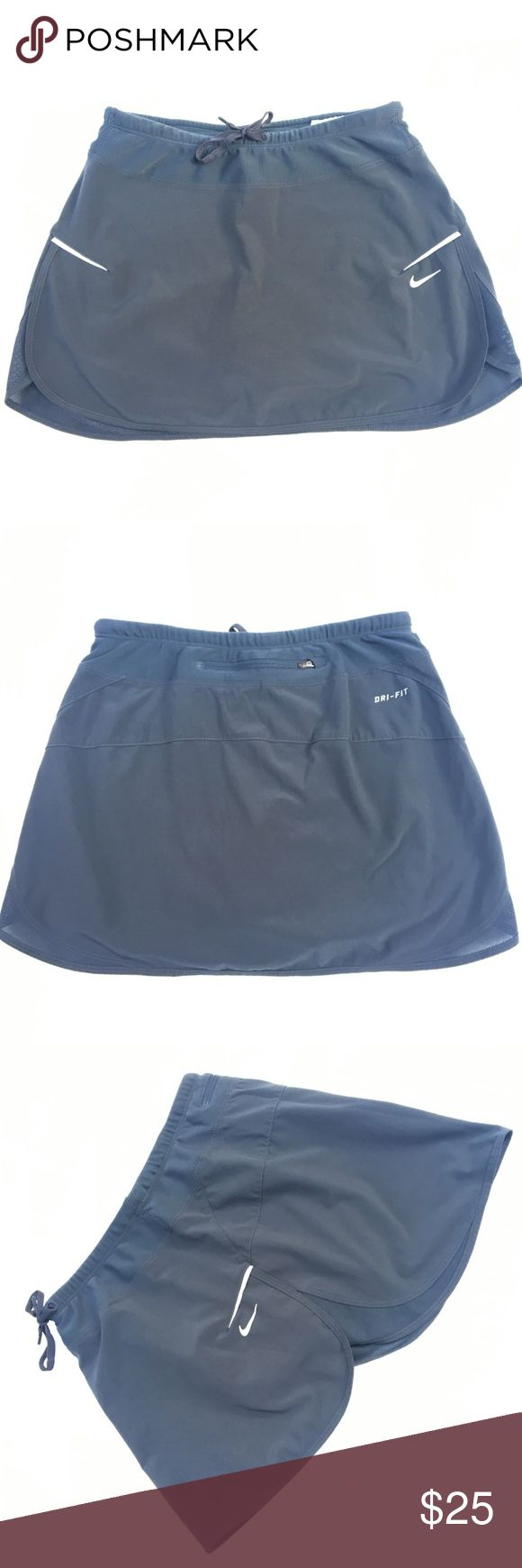 "Nike Running Skort Mini Skirt Gray Dri Fit XS WA8 Nike Women's Shorts Gray Dri-Fit Running Skirt over Shorts, A Line, Reflective Swoosh and Sides.  Back Zipper Waist Pouch.  Drawstring Waist, Overlap Side Split on Skirt. Size: XS X Small  Pit to Pit: ""  Waist: 12""  Inseam: 3.5"" Length: 11.75""  Condition: Very Good. Comes from a pet and smoke free environment!  Please review pictures and contact me if you have any questions. Color: Gray  Material: 86% Polyester, 14% Spandex Country: Singapore…"