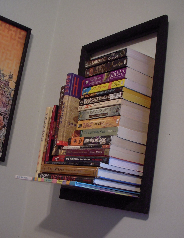 An Invisible Bookshelf Plus An Empty Picture Frame