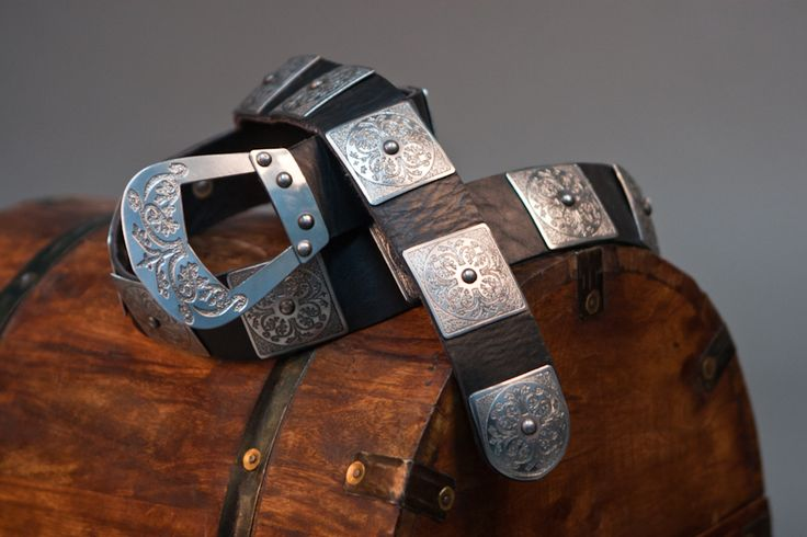 This hand crafted Armor Belt is a stunning, detailed belt that is great for any medieval garb. Wear chain-mail or a gambeson? Perfect! This belt has unique and marvelous details that would make any would be knight envious. $99.99 http://www.pearsonsrenaissanceshoppe.com/armor-belt-with-steel-accents.html #leather #belt #medieval